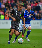 Lincoln City's Harry Anderson vies for possession with  Macclesfield Town's Danny Whittaker<br /> <br /> Photographer Andrew Vaughan/CameraSport<br /> <br /> The EFL Sky Bet League One - Macclesfield Town v Lincoln City - Saturday 15th September 2018 - Moss Rose - Macclesfield<br /> <br /> World Copyright &copy; 2018 CameraSport. All rights reserved. 43 Linden Ave. Countesthorpe. Leicester. England. LE8 5PG - Tel: +44 (0) 116 277 4147 - admin@camerasport.com - www.camerasport.com