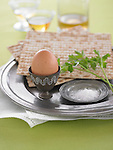 Ingredients for a Passover plate–brown egg, matzo bread, parsley sprig, and sea salt. <br />