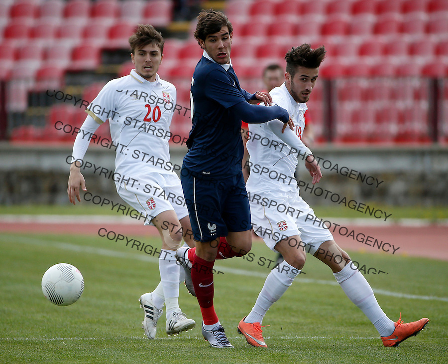 KRAGUJEVAC, SERBIA - MARCH 29: Theo (C) of France in action against Milan Senic (R) and Matija Spoljaric (L) of Serbia during the UEFA European U19 Championship Elite Round Group 7 match between Serbia and France at Stadium Cika Daca on March 29, 2016 in Kragujevac, Serbia. (Photo by Srdjan Stevanovic/Getty Images)