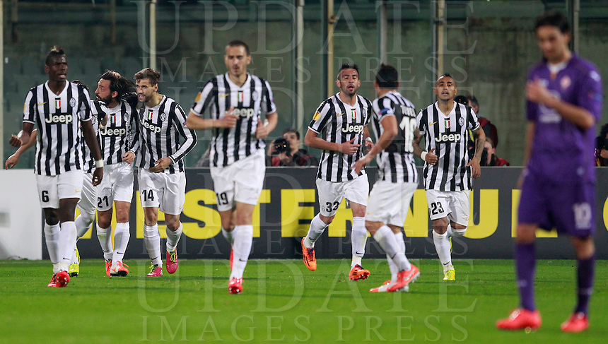 Calcio, ritorno degli ottavi di finale di Europa League: Fiorentina vs Juventus. Firenze, stadio Artemio Franchi, 20 marzo 2014. <br /> Juventus midfielder Andrea Pirlo, second from left, celebrates with teammates after scoring the winning goal on a free kick during the Europa League round of 16 second leg football match between Fiorentina and Juventus at Florence's Artemio Franchi stadium, 20 March 2014. Juventus won 1-0 to advance to the quarter-finals.<br /> UPDATE IMAGES PRESS/Isabella Bonotto