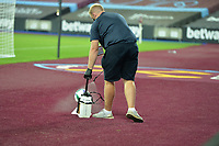 Covid 19 the match ball is disinfected during West Ham United vs Charlton Athletic, Caraboa Cup Football at The London Stadium on 15th September 2020