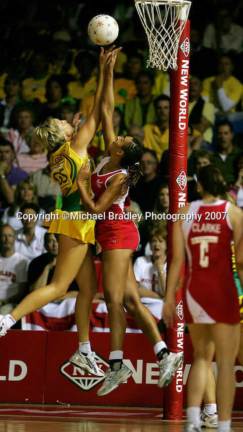 16.11.2007 Australian Catherine Cox and England's Geva Mentor in action during the Australia v England match at the New World Netball World Champs held at Trusts Stadium Auckland New Zealand. Mandatory Photo Credit ©Michael Bradley.