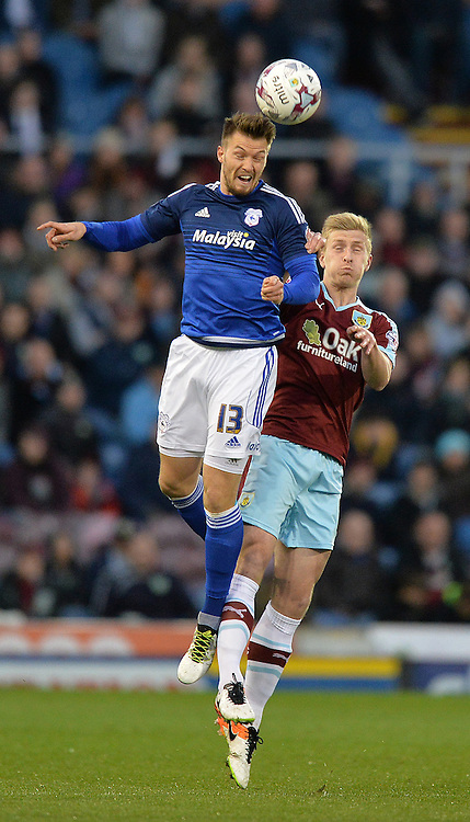 Burnley's Michael Keane is out jumped by Cardiff City's Anthony Pilkington<br /> <br /> Photographer Dave Howarth/CameraSport<br /> <br /> Football - The Football League Sky Bet Championship - Burnley v Cardiff City  - Tuesday 5th April 2016 - Turf Moor - Burnley <br /> <br /> &copy; CameraSport - 43 Linden Ave. Countesthorpe. Leicester. England. LE8 5PG - Tel: +44 (0) 116 277 4147 - admin@camerasport.com - www.camerasport.com