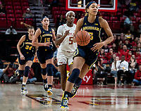 COLLEGE PARK, MD - DECEMBER 28: Kaila Charles #5 of Maryland chases after Kayla Robbins #5 of Michigan. during a game between University of Michigan and University of Maryland at Xfinity Center on December 28, 2019 in College Park, Maryland.
