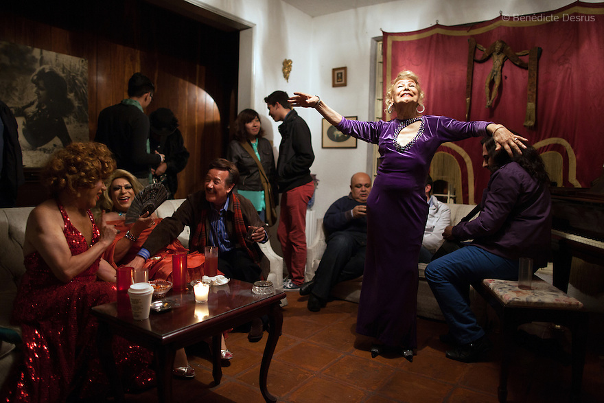 "July 13, 2013 - Mexico City, Mexico - Samantha celebrates her 81st birthday with close friends in Mexico City. Samantha Flores is an 81-year-old transgender woman from Veracruz, Mexico. She is a prominent social activist for LGBTQI rights and is the founder of the non-profit organization ""Laetus Vitae"", a day shelter for elderly gay people in Mexico City. Senior citizens in general are many times prone to neglect and abandonment by their families, leaving them all but invisible. Their plight can be even worse if they are homosexual. Photo credit: Bénédicte Desrus"