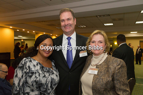 The Hyde Park Chamber of Commerce held its 96th Annual Anniversary Dinner Thursday evening at the LaQuinta Inn and Suites located at 4900 S. Lake Shore Drive.<br /> <br /> 7629 &ndash; Executive Director for the South-East Chicago Commission, Wendy Walker Williams, President of the Hyde Park Bank and Year of Civic Service award winner, Mike McGarry and Deborah E. Hart of Montgomery Place<br /> <br /> Please 'Like' &quot;Spencer Bibbs Photography&quot; on Facebook.<br /> <br /> All rights to this photo are owned by Spencer Bibbs of Spencer Bibbs Photography and may only be used in any way shape or form, whole or in part with written permission by the owner of the photo, Spencer Bibbs.<br /> <br /> For all of your photography needs, please contact Spencer Bibbs at 773-895-4744. I can also be reached in the following ways:<br /> <br /> Website &ndash; www.spbdigitalconcepts.photoshelter.com<br /> <br /> Text - Text &ldquo;Spencer Bibbs&rdquo; to 72727<br /> <br /> Email &ndash; spencerbibbsphotography@yahoo.com