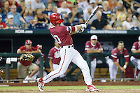 Indiana Hoosiers outfielder Casey Smith (20) swings the bat against the Oregon State Beavers during Game 9 of the 2013 Men's College World Series  on June 19, 2013 at TD Ameritrade Park in Omaha, Nebraska. The Beavers defeated the Hoosiers 1-0, eliminating Indiana from the tournament. (Andrew Woolley/Four Seam Images)