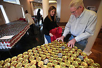 NWA Democrat-Gazette/J.T. WAMPLER Randy Imbeau (right) of Springdale loads canned goods into a bag held by Donna Katzfey of Fayetteville Sunday Dec. 1, 2019 Volunteers put together food packages for homebound seniors and their dogs and cats. The packages will be distributed to home-bound seniors through the Prairie Grove, Farmington, and Elkins senior centers. More than 200 seniors will receive the packages and the seniors with pets will get food for them as well. More than fifteen thousand pounds of food was donated for the event organized by the Chase Family Foundation. The bags were loaded at the Chase family home in Springdale.