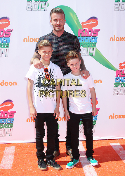 LOS ANGELES, CA - JULY 17: David Beckham, Romeo James Beckham, and Cruz David Beckham at Nickelodeon Kids' Choice Sports Awards 2014 at Pauley Pavilion on July 17, 2014 in Los Angeles, California. <br /> CAP/MPI/MPI99<br /> &copy;MPI99/ MediaPunch/Capital Pictures