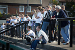 Home supporters watching the first-half action at the Mersey Travel Arena, home to Marine Football Club, as they played host to Ilkeston FC in a Northern Premier League premier division match. The match was won by the home side by 3 goals to 1 and was watched by a crowd of 398. Marine are baed in Crosby, Merseyside and have played at Rossett Park (now the Mersey Travel Arena)  since 1903, the club having been formed in 1894.