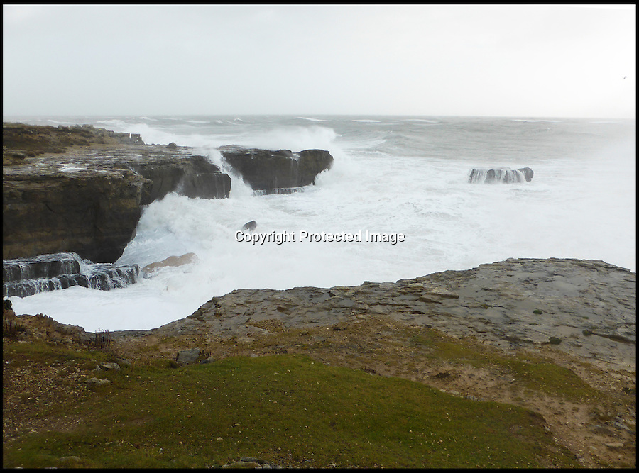 BNPS.co.uk (01202 558833)<br /> Pic: StuartMorris/BNPS<br /> <br /> ***Please use full byline***<br /> <br /> Waves wash over the rock in recent storms. <br /> <br /> A huge, ancient stack of rock was destroyed after constant pounding by ferocious waves on the southern tip of Portland, Dorset.<br /> <br /> The rock, known as Pom Pom Rock, is said to weigh hundreds of tonnes and dates back 150 million years to the Jurassic age.
