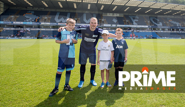 Ash Buckenham with mascots during the Sellebrity Soccer match for Wycombe Sports & Education Trust at Wycombe Wanderers, Adams Park, High Wycombe, England on 28 May 2018. Photo by Andy Rowland.
