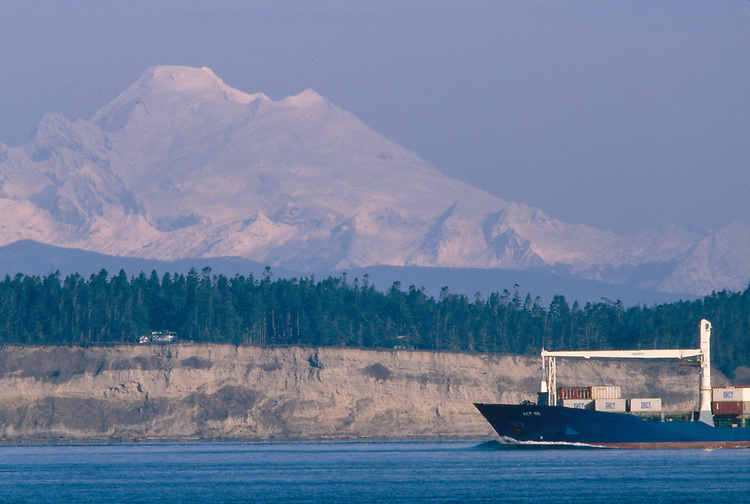 Whidbey Island, Mount Baker, Puget Sound, Admiralty Inlet, Washington State, Pacific Northwest, USA, sand bluffs are actually glacial till, container ship is outbound for the Strait of Juan de Fuca, and the Pacific Ocean