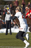 Boston College midfielder Kate McCarthy (20) on the attack as Boston University midfielder Ally Adams (15) defends..Boston College (white) defeated Boston University (red), 12-9, on the Newton Campus Lacrosse Field at Boston College, on March 20, 2013.