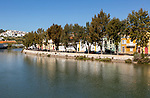 Historic homes on the waterfront of the river Rio Séqua, Tavira, Algarve, Portugal, southern Europe