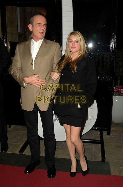 FRANCIS ROSSI & GUEST.3rd Annual Classic Rock Roll Of Honour Awards Gala, The Landmark Hotel, London, England,.November 5th 2007..full length.CAP/CAN.©Can Nguyen/Capital Pictures