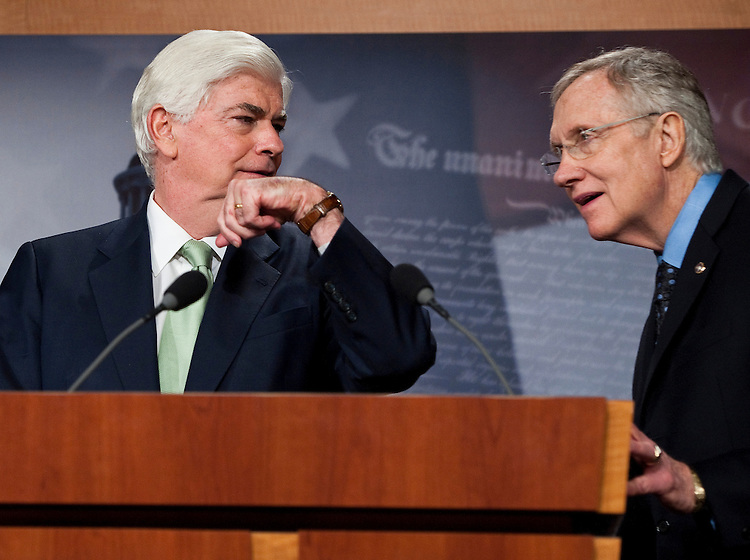 UNITED STATES - JULY 15: Sen. Chris Dodd, D-Conn.,  shows his watch to Senate Majority Leader Harry Reid, D-Nev., during their news conference following the passage of the financial reform bill on Thursday, July 15, 2010. A reporter asked the Senators for reaction to House Republican Leader Boehner's call for repeal of the bill. (Photo By Bill Clark/Roll Call via Getty Images)