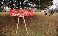 NWA Media/ANDY SHUPE - Volunteers walk past a sign warming of the volume of the cannons during a re-enactment of the Battle of Prairie Grove Saturday, Dec. 6, 2014, at Battlefield State Park in Prairie Grove. This is the 152nd anniversary of the battle which took place Dec. 7, 1862 between 12,000 Confederate and 10,000 Federal soldiers. Visit nwamedia.photoshelter.com to see more photographs from the battle.