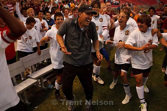 Sandy - Mountain View coach Mark Graham gets a celebratory soaking. Mountain View vs. Woods Cross High School boys soccer, 4A state championship game Thursday May 21, 2009 at Rio Tinto Stadium.