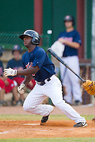 Jamaal Hawkins #12 of the Elizabethton Twins follows through on his swing against the Kingsport Mets at Joe O'Brien Field August 14, 2010, in Elizabethton, Tennessee.  Photo by Brian Westerholt / Four Seam Images