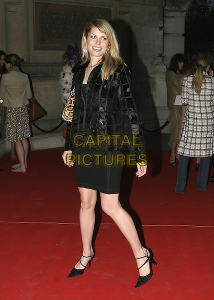 MERIDITH OSTROM.DeBeersLV - launch party.Victoria & Albert Museum, SW7.May 17th, 2005.full length black green jacket skirt looking over shoulder.www.capitalpictures.com.sales@capitalpictures.com.© Capital Pictures.