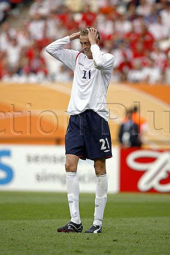 15 June 2006: England striker Peter Crouch holds his head in his hands during the Fifa World Cup Group B match between England and Trinidad and Tobago played at the Franken-Stadion, Nuremberg. England won the game 2-0. Photo: Neil Tingle/actionplus...060615 football soccer player disappointment loser losing
