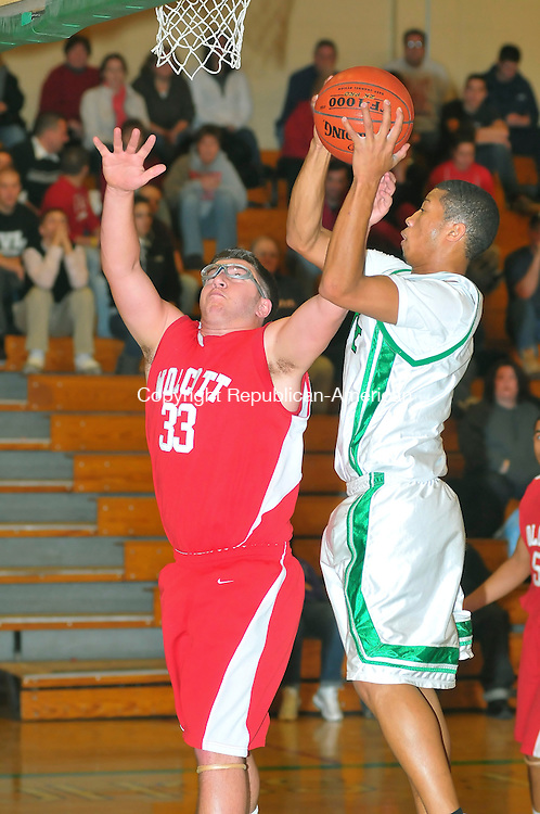WATERBURY, CT-02 JANUARY 2010-010102JS11- Wolcott's Joe Murphy (33) tries to block a shot by Wilby's Landen Manning (1) during their game Saturday at Wilby High School. <br /> Jim Shannon Republican-American