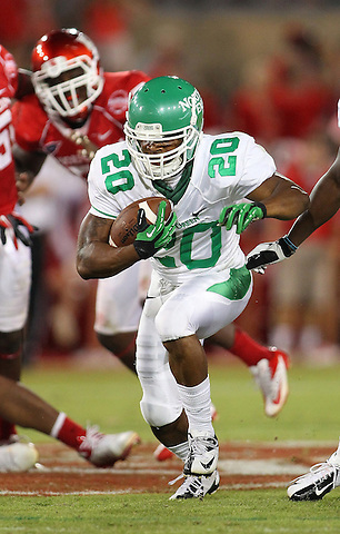 Denton, TX - OCTOBER 6: running back Jeremy Brown #20 of the North Texas Mean Green carries the ball against the Houston Cougars defense at Robertson Stadium in Houston on October 6, 2012 in Houston, Texas. Photo by: Rick Yeatts