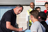 Swansea City Manager Paul Clement signs for supporters during the 2017/18 Pre Season Friendly match between Barnet and Swansea City at The Hive, London, England on 12 July 2017. Photo by Andy Rowland.