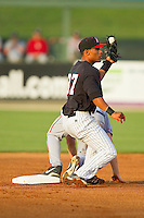 Micah Johnson (37) of the Kannapolis Intimidators looks to the umpire for a call after applying a tag to a Hagerstown Suns runner at CMC-Northeast Stadium on May 17, 2013 in Kannapolis, North Carolina.  The Suns defeated the Intimidators 9-7.   (Brian Westerholt/Four Seam Images)