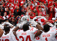 "Ohio State University football players sing ""Carmen Ohio"" following a 60-35 win over Illinois during the second half of Saturday's NCAA Division I football game at Memorial Stadium in Champaign, Il., on November 16, 2013. (Barbara J. Perenic/The Columbus Dispatch)"