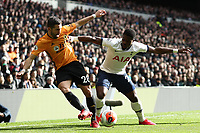 1st March 2020; Tottenham Hotspur Stadium, London, England; English Premier League Football, Tottenham Hotspur versus Wolverhampton Wanderers; Serge Aurier of Tottenham Hotspur competes for the ball with João Moutinho of Wolverhampton Wanderers
