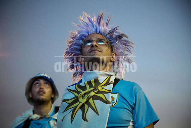 """Uruguayan fans disconsolate watch at the fan fest on Copacabana beach match between Cosa Rica and Uruguay made in Fortaleza. Eventually """"La Celeste"""" would be defeated by Costa Rica, 1-3. Rio de Janeiro, Brazil."""
