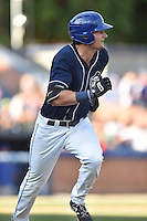 Asheville Tourists left fielder Sam Hilliard (25) runs to first base during a game against the Columbia Fireflies at McCormick Field on June 18, 2016 in Asheville, North Carolina. The Tourists defeated the Fireflies 5-4. (Tony Farlow/Four Seam Images)