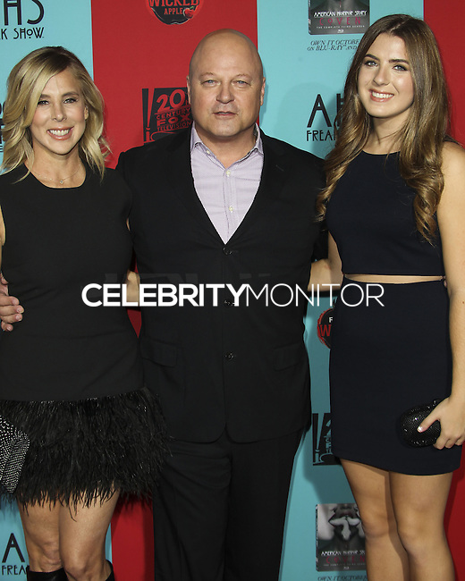 HOLLYWOOD, LOS ANGELES, CA, USA - OCTOBER 05: Michelle Moran, Michael Chiklis, Odessa Chiklis arrive at the Los Angeles Premiere Screening Of FX's 'American Horror Story: Freak Show' held at the TCL Chinese Theatre on October 5, 2014 in Hollywood, Los Angeles, California, United States. (Photo by Celebrity Monitor)