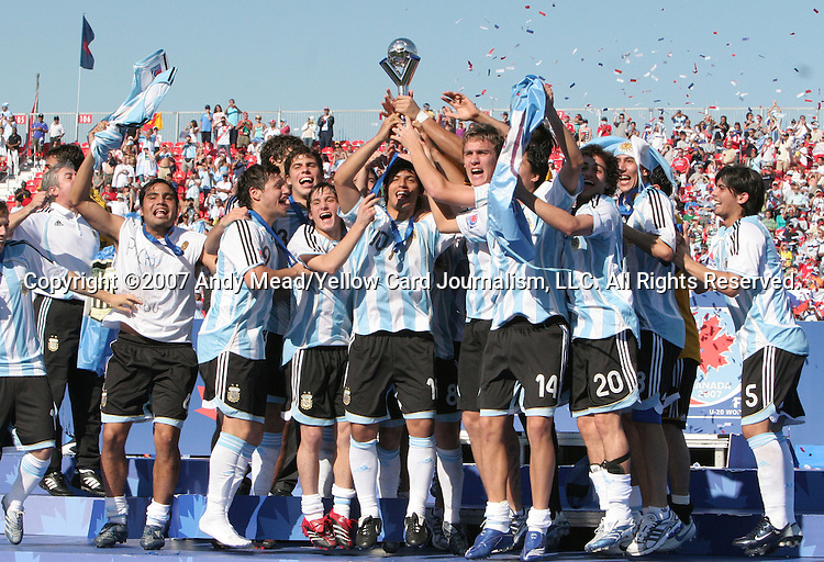 22 July 2007: Argentina captains Sergio Aguero (10) and Matias Cahais (r) hold up the World Cup championship trophy as their teammates celebrate. During the postgame ceremony after the FIFA U-20 World Cup Canada 2007 Championship Match played at the National Soccer Stadium, also known as BMO Field, in Toronto, Ontario, Canada.