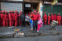 A Red Ants major carries out two small children during the eviction of residents from a so-called 'hijacked' building on Bree Street. The Red Ants are a controversial private security company often hired to clear squatters from land and so-called 'hijacked' properties.