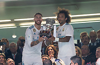 Real Madrid's Spanish defense Sergio Ramos and Real Madrid´s Brazilian defense Marcelo lift the trophy of Super Cup of Spain