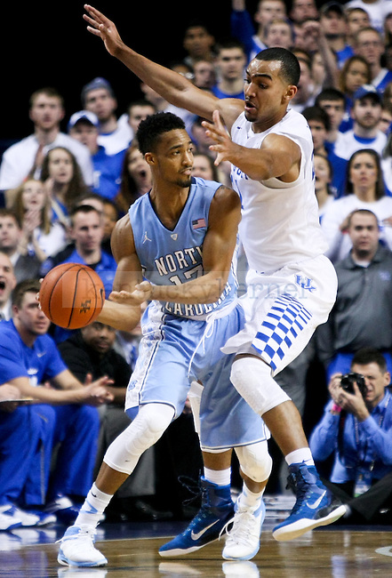 Kentucky forward Trey Lyles plays tough defense on a North Carolina player during the first half of the University of Kentucky men's basketball game vs. University of North Carolina at Rupp Arena in Lexington , Ky., on Saturday, December 13, 2014. Photo by Jonathan Krueger | Staff