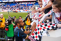 Thierry Henry (14) of the New York Red Bulls signs autographs after defeating the Philadelphia Union. The New York Red Bulls defeated the Philadelphia Union 2-1 during a Major League Soccer (MLS) match at Red Bull Arena in Harrison, NJ, on March 30, 2013.