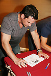 Tyler Christopher - General Hospital looks at drawing done by fan Kaitlyn in pink sweatshirt at Uncle Vinny's/Ferraras at the Crown Plaza in Trevose, Pennsylvania on April 22, 2010 to see fans with a q & a and autographs and taking of photos. (Photo by Sue Coflin/Max Photos0