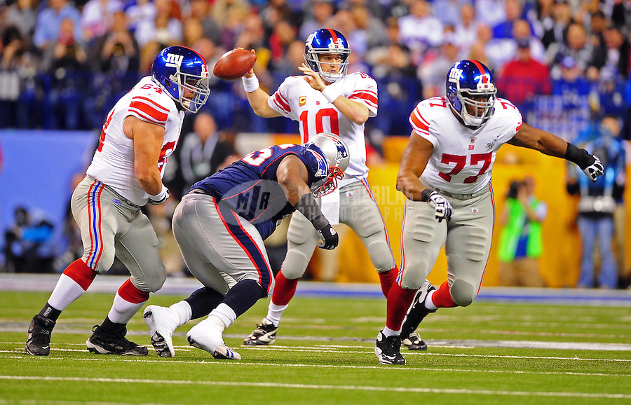 Feb 5, 2012; Indianapolis, IN, USA; New York Giants quarterback Eli Manning (10) throws a pass during the first half of Super Bowl XLVI against the New England Patriots at Lucas Oil Stadium.  Mandatory Credit: Mark J. Rebilas-