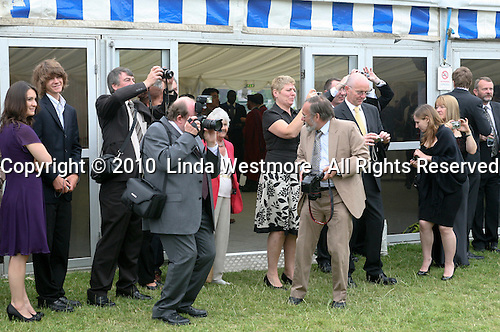 Family & friends queue up to take photos after the graduation ceremony, University of Surrey.