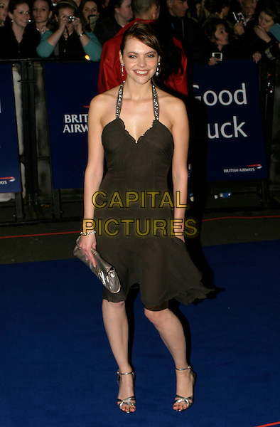KATE FORD.National Television Awards 2005 at the Royal Albert Hall, SW7, London, UK..October 25th, 2005.Ref: AH.full length brown dress halterneck.www.capitalpictures.com.sales@capitalpictures.com.© Capital Pictures.