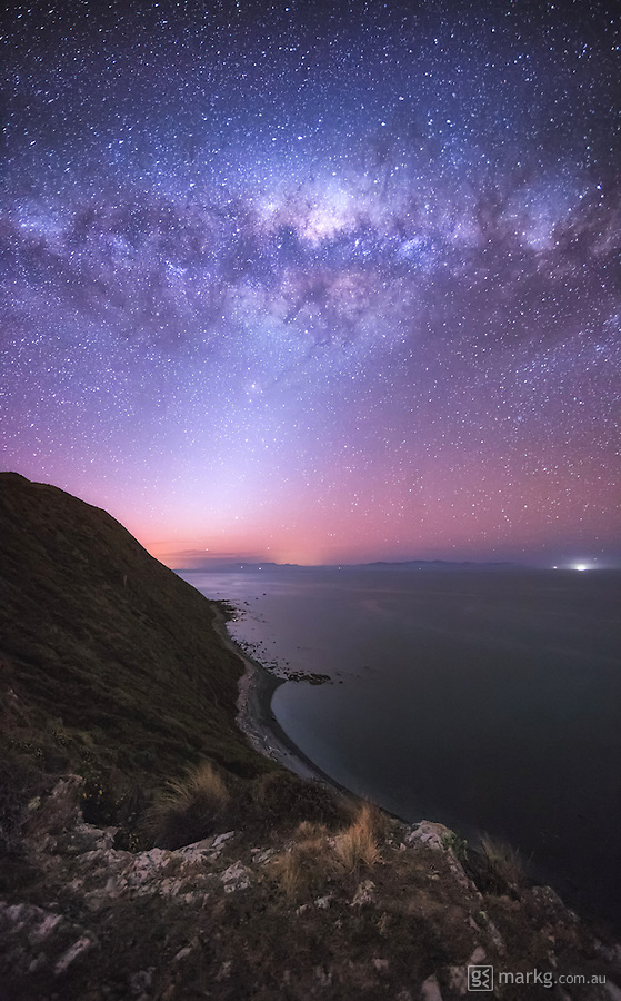 I shot on the west coast of Wellington, New Zealand as the galactic core of the Milky Way was beginning to dip towards the horizon. The white triangular glow coming up from the horizon is the Zodiacal Light, which is caused by space dust scattering sunlight in the zodiacal cloud. It was amazing up there on the ridge that night under a sky full of stars…it's something everyone should do every now and then.