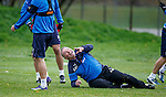 Ally McCoist flies in to win the ball but falls over after winning the tackle and laughs