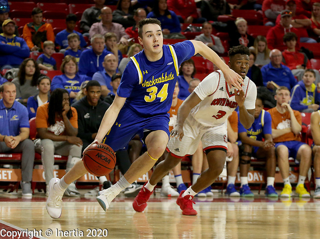 VERMILLION, SD - JANUARY 19: Alex Arians #34 of South Dakota State Jackrabbits drives baseline past Triston Simpson #3 of South Dakota Coyotes at the Sanford Coyote Center on January 19, 2020 in Vermillion, South Dakota. (Photo by Dave Eggen/Inertia)