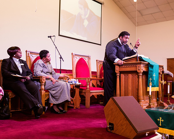 February 10, 2017. Raleigh, North Carolina.<br />  <br /> Rev. Dr. William J. Barber, the president of the North Carolina chapter of the NAACP and the leader of the Moral Mondays movement, speaks from the podium at a pre-HKONJ service at Rush Metropolitan A.M.E. Zion Church.<br /> <br /> On the evening before the annual HKONJ People's Assembly, a civil rights march tied to the Moral Monday movement, religious leaders from around the country gathered at Rush Metropolitan A.M.E. Zion Church to rally their supporters and speak out against nationwide attacks on civil rights and the Trump administration.<br /> <br /> Jeremy M. Lange for The New York Times