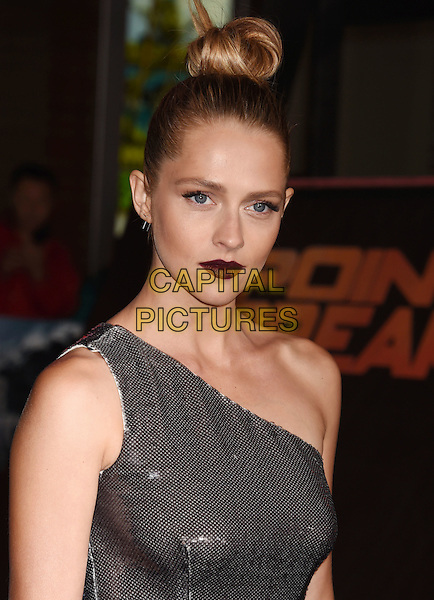 HOLLYWOOD, CA - DECEMBER 15: Actress Teresa Palmer  attends the premiere of Warner Bros. Pictures' 'Point Break' at TCL Chinese Theatre on December 15, 2015 in Hollywood, California.<br /> CAP/ROT/TM<br /> &copy;TM/ROT/Capital Pictures