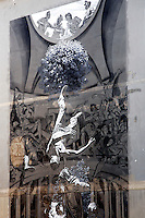 Titolo: Hostia,  Artista Nicola Verlato<br /> Title Hostia, Artist Nicola Verlato<br /> Murale dedicato a Pierpaolo Pasolini.L'immagine, potente e suggestiva, da vita ad un affresco drammatico. al centro Pasolini appena ucciso, precipita in un girone infernale. Lo osserva dall'altro il suo assassino, tra giornalisti e carabinieri, mentre in basso, il poeta bambino dedica delle liriche alla madre, sotto gli auspici di Petrarca e di Ezra Pound, il primo conosciuto da Pasolini come maestro, distrante per formazione politica, ma vicinissimo per sensibilità' poetica.<br /> Mural dedicated to Pierpaolo Pasolini. In the centre of the painting, Pasolini, just killed, fall down into an infernal spiral. Above him, his killer, surrounded by journalists and police. At the bottom of the painting, the young artist, recites a poetry to her mother, supported by Petrarca and Ezra Pound.<br /> Roma 01-02-2015 Street Art a Roma. In vari quartieri di Roma e' fiorita la Street Art, con splendidi murales che hanno lo scopo di raccontare delle storie della citta', di commemorare dei momenti importanti, o semplicemente di interpretarla.<br /> Street Art in Rome. Very important writers  painted Murales in various districts of Rome to tell stories about the city, to commemorate important moments, to embellish the quarter or simply to portray it.  <br /> Photo Samantha Zucchi Insidefoto